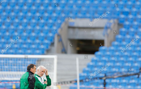 Ireland coach Giovanni Trapattoni, right, talks to assistant Marco Tardelli during a training session on the eve of the Euro 2012 soccer championship Group C match between Italy and Ireland in Poznan, Poland
