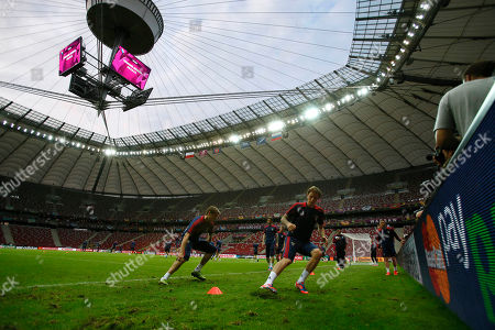 Members of the Russia national soccer squad including Russia's Roman Pavlyuchenko, second left, take part in the official training session on the eve of the Euro 2012 soccer championship Group A match between Poland and Russia in Warsaw, Poland