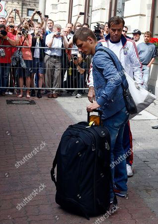 Russia's Andrei Arshavin leave the Bristol hotel after the Russian team failed to advance from the Group A at the Euro 2012 soccer championship in Warsaw, Poland