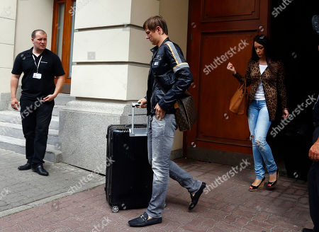 Russia's Roman Pavlyuchenko leave the Bristol hotel after the Russian team failed to advance from the Group A at the Euro 2012 soccer championship in Warsaw, Poland