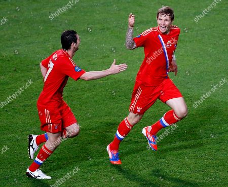 Russia's Roman Pavlyuchenko, right, celebrates after scoring his side's fourth goal during the Euro 2012, Group A soccer match between Russia and Czech Republic, in Wroclaw, Poland