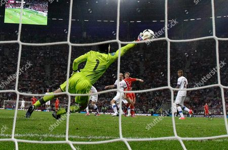 Russia's Roman Pavlyuchenko, center in red, scores past Czech goalkeeper Petr Cech during the Euro 2012 soccer championship Group A match between Russia and Czech Republic in Wroclaw, Poland
