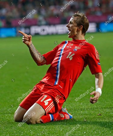 Russia's Roman Pavlyuchenko celebrates after scoring his side's fourth goal during the Euro 2012, Group A soccer match between Russia and Czech Republic, in Wroclaw, Poland