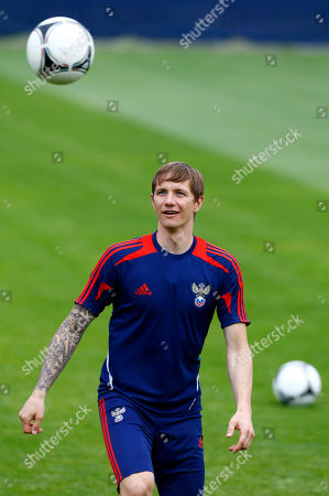 Russia's Roman Pavlyuchenko looks at the ball during a training session of Russia at the Euro 2012 soccer championship in Sulejowek, Poland