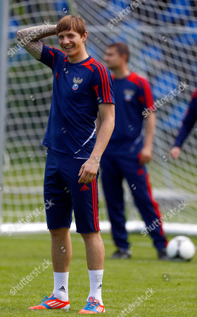 Russia's Roman Pavlyuchenko smiles during a training session at the Euro 2012 soccer championship in Warsaw, Poland