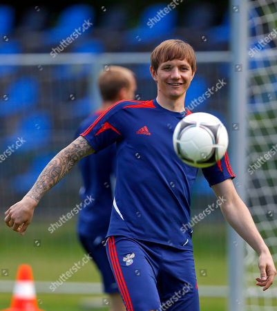 Russia's Roman Pavlyuchenko controls the ball during a training session of Russia at the Euro 2012 soccer championship in Warsaw, Poland