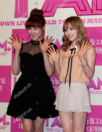 """Tiffany, Sooyoung Tiffany, left, and Sooyoung, members of South Korean K-pop group Girls' Generation, pose during a promotional event for the movie """"I AM"""" at a theater in Seoul, South Korea"""