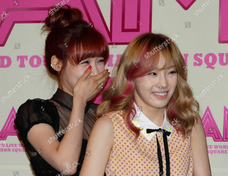 """Tiffany, Sooyoung Tiffany, left, and Sooyoung, members of South Korean K-pop group Girls' Generation, smile during a promotional event for the movie """"I AM"""" at a theater in Seoul, South Korea"""