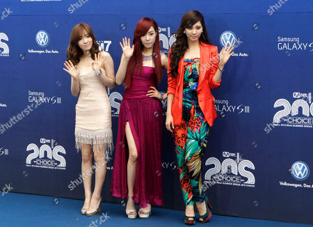"Tae Yeon, Tiffany, Seohyun South Korean girl group ""Girls' Generation"" members Tae Yeon, left, Tiffany and Seohyun, right, pose before the 2012 Mnet 20's Choice award ceremony in Seoul, South Korea"
