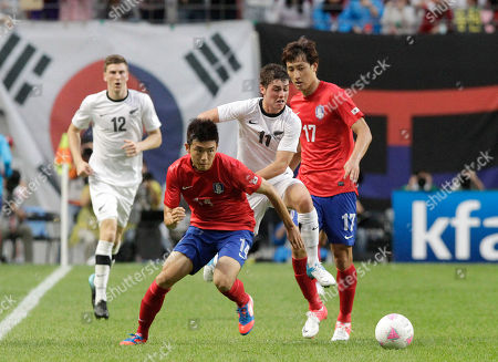 Macro Rojas, Yun Sun-young New Zealand's Macro Rojas (11) fights for the ball against South Korea's Yun Sun-young (14) during Olympic qualifiers' friendly soccer match in Seoul, South Korea, . South Korea defeated New Zealand 2-1