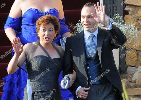 Andres Iniesta, Anna Ortiz FC Barcelona's Andres Iniesta, right, is seen with mother during his wedding at the castle of Tamarit in Tarragona, Spain