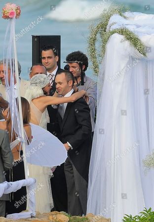 Andres Iniesta, Anna Ortiz FC Barcelona's Andres Iniesta, right, is seen with his wife Anna Ortiz during his wedding at the castle of Tamarit in Tarragona, Spain
