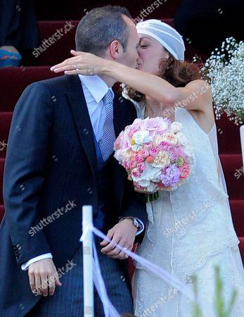 Andres Iniesta, Anna Ortiz FC Barcelona's Andres Iniesta kisses his wife Anna Ortiz during his wedding at the castle of Tamarit in Tarragona, Spain
