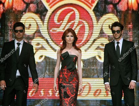 Anna Chapman Russian ex-spy Anna Chapman, center, walks a Turkish catwalk flanked by two men posing as secret service agents at a fashion show in Antalya, Turkey. The 30-year-old Chapman was deported from the United States in 2010 along with nine other Russian sleeper agents