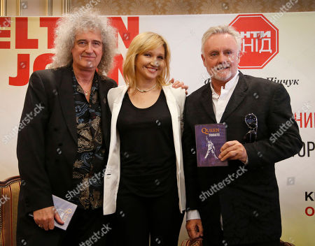 Brian May, Elena Pinchuk, Roger Taylor Brian May, left, and Roger Taylor, right, of rock group Queen pose for photo with Elena Pinchuk, center, after a press conference in Kiev, Ukraine, . On June 30, 2012, at the invitation of the Elena Pinchuk Foundation Elton John, Adam Lambert and Queen will perform to hundreds and thousands of soccer fans in the Fan Zone at Independence Square in Kiev