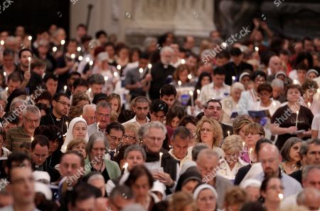 "Pope Benedict XVI Faithful hold candles during the opening day of Rome's dioceses ecclesiastic meeting at St. John at the Lateran Basilica in Rome, . Pope Benedict XVI called for his aides near and far to remain loyal to him as the Vatican copes with the fallout of a growing scandal over leaked documents and the controversial ouster of Ettore Gotti Tedeschi. The Vatican says it ""truly regrets"" the publication of a letter from a psychotherapist detailing the mental health of the Vatican's recently ousted bank chief. In a statement to The Associated Press, Vatican spokesman the Rev. Federico Lombardi said the publication of the letter was ""completely unacceptable and cause for true regret, in particular from the point of view of the respect that should be owed to the interested people"