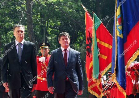 Albania's President Bamir Topi, right, and his Montenegro counterpart Filip Vujanovic inspect an honour guard during a welcoming ceremony in Tirana . Vujanovic is on a two-day official visit