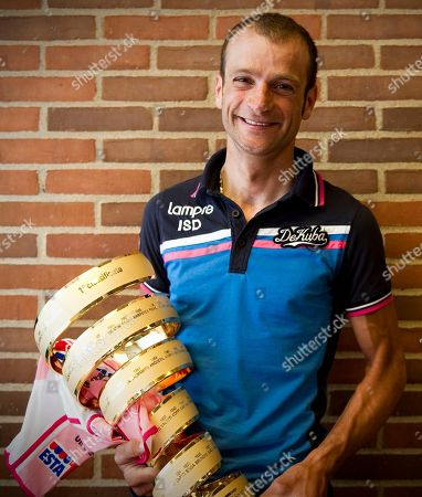 Michele Scarponi Michele Scarponi shows the trophy of 2011 edition of the Giro d'Italia cycling race after Alberto Contador was stripped of the honor for doping, in Herning, Denmark. Extending the fallout from the Lance Armstrong doping report, at least 15 more cyclists are being linked to the American's banned physician in what is unfolding as an intricate scheme of money laundering, tax evasion and widespread doping. The Gazzetta dello Sport reports that former Giro d'Italia winners Michele Scarponi and Denis Menchov, plus this year's Olympic champion Alexandre Vinokourov, are under investigation for doping under the supervision of Dr. Michele Ferrari