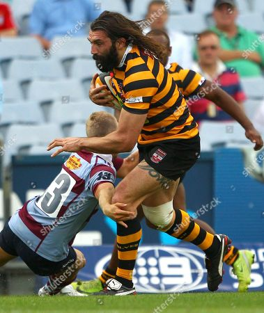 Sebastien Chabal, James Walsh French rugby player Sebastien Chabal, playing for Balmain, right, breaks through the tackle by Petersham's James Walsh during a club rugby game against Petersham in Sydney, Australia