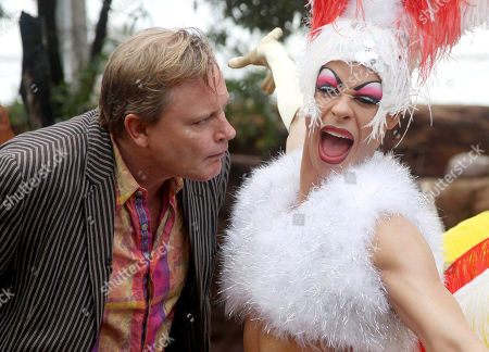 """Stephan Elliott Stephan Elliott, left, director of the 1994 comedy """"The Adventures of Priscilla, Queen of the Desert,"""" takes a close look at a wax statue of actor Guy Pearce on display for the new Sydney Madame Tussauds museum at Wildlife World in Darling Harbour in Sydney, Australia, . Pearce played the flamboyantly dressed Felicia in the film that portrayed three drag queens' journey across Australia's tough and harsh outback"""