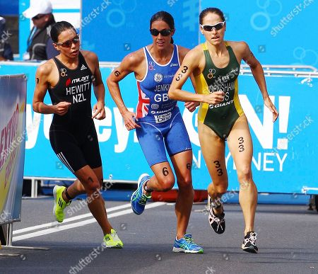 Australia's Erin Densam, right, Britain's Helen Jenkins center, and New Zealand's Andrea Hewitt race in the run leg of the elite women's race at the ITU World Triathlon Series in Sydney, Australia