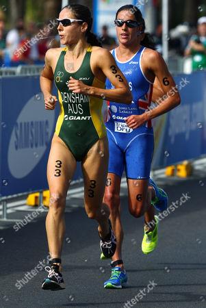 Australia's Erin Densam, left, Britain's Helen Jenkins, center, and New Zealand's Andrea Hewitt, obscured at back, race in the run leg of the elite women's race at the ITU World Triathlon Series in Sydney, Australia