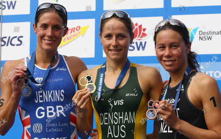 The medal winners, Australia's Erin Densham, center, Britain's Helen Jenkins and New Zealand's Andrea Hewitt, right, from the elite women at the ITU World Triathlon Series show their medals in Sydney, Australia, . Densham won gold, Jenkins took silver and Hewitt took the bronze
