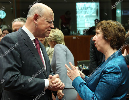 Uri Rosenthal, Catherine Ashton EU foreign policy chief Catherine Ashton, right, talks with Dutch Foreign Minister Uri Rosenthal, prior to the start of an EU foreign affairs meeting at the European Council building in Brussels