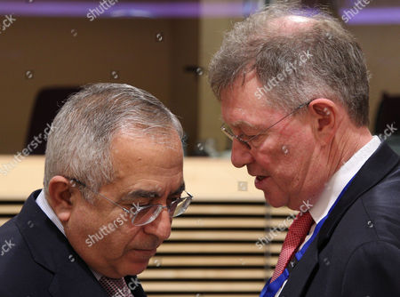 Robert H. Serry, Salam Fayyad Prime Minister of the Palestinian National Authority Salam Fayyad, left, talks with United Nations Special Coordinator for the Middle East Peace Process Robert H. Serry, during a donor coordination group for the Palestinian people, at the European Commission headquarters in Brussels