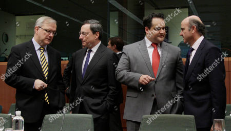 Olli Rehn, Mario Draghi, Jan Kees De Jager, Luis de Guindos From left, European Commissioner for the Economy Olli Rehn, European Central Bank President Mario Draghi, Dutch Finance Minister Jan Kees De Jager and Spain's Economy Minister Luis de Guindos share a word during a meeting of eurozone finance ministers at the EU Council building in Brussels on . The 17 euro countries are trying to focus on issues beyond the Greek crisis and deal with longer-term issues in their currency union. Finance ministers, meeting in Brussels on Monday, will discuss Spain's high deficits and potentially dangerous imbalances in other countries