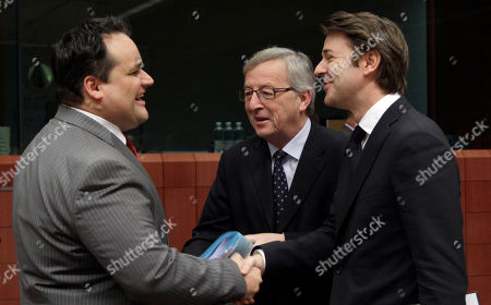 Jan Kees De Jager, Jean-Claude Juncker, Francois Baroin Dutch Finance Minister Jan Kees De Jager, left, speaks with Luxembourg's Prime Minister Jean-Claude Juncker, center, and French Finance Minister Francois Baroin, right, during a meeting of eurozone finance ministers at the EU Council building in Brussels on . The 17 euro countries are trying to focus on issues beyond the Greek crisis and deal with longer-term issues in their currency union. Finance ministers, meeting in Brussels on Monday, will discuss Spain's high deficits and potentially dangerous imbalances in other countries