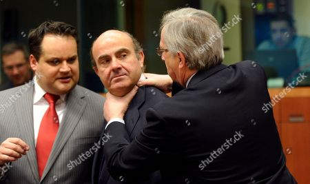 Luis de Guindos, Jean-Claude Juncker, Jan Kees De Jager Luxembourg's Prime Minister Jean-Claude Juncker, right, puts his hands on the neck of Spain's Economy Minister Luis de Guindos, center, as Dutch Finance Minister Jan Kees De Jager, right, looks on during a meeting of eurozone finance ministers at the EU Council building in Brussels on . The 17 euro countries are trying to focus on issues beyond the Greek crisis and deal with longer-term issues in their currency union. Finance ministers, meeting in Brussels on Monday, will discuss Spain's high deficits and potentially dangerous imbalances in other countries