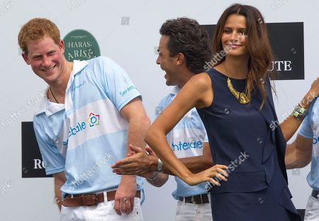 Prince Harry Britain's Prince Harry, left, smiles after greeting Brazil's model Fernanda Motta, right, during the award ceremony after playing a charity polo match in Campinas, Brazil, . Prince Harry is in Brazil at the request of the British government on a trip to promote ties and emphasize the transition from the upcoming 2012 London Games to the 2016 Olympics in Rio de Janeiro