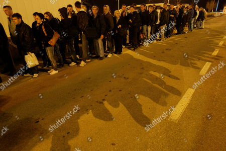 Supporters of Fikret Abdic, a former Muslim warlord in western Bosnia, wait to cross the border between Bosnia and Herzegovina and Croatia near town of Velika Kladusa, about 400 kilometers north west from Bosnian capital of Sarajevo, . More than 20,000 supporters headed to the Croatian town of Pula to celebrate release of Abdic after he served 10 years in jail for war crimes in his former homeland