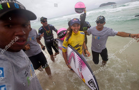 Australia's Sally Fitzgibbons, second from right, celebrates after winning the Association of Surfing Professionals (ASP) Billabong Rio Pro women's surfing competition at Barra da Tijuca beach in Rio de Janeiro, Brazil