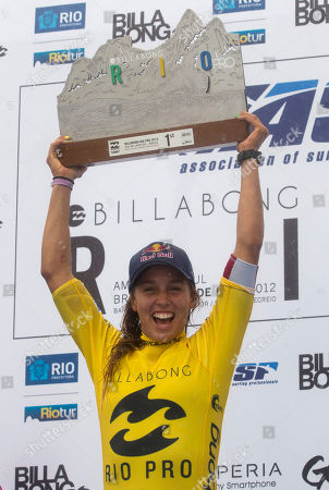 Australia's Sally Fitzgibbons holds up the Association of Surfing Professionals (ASP) Billabong Rio Pro women's surfing trophy after wining the competition at Barra da Tijuca beach in Rio de Janeiro, Brazil