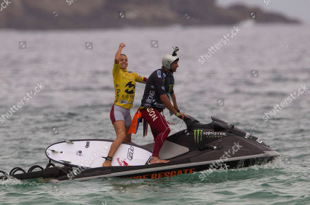 Australia's Sally Fitzgibbons, left, celebrates after winning the Association of Surfing Professionals (ASP) Billabong Rio Pro women's surfing competition at Barra da Tijuca beach in Rio de Janeiro, Brazil