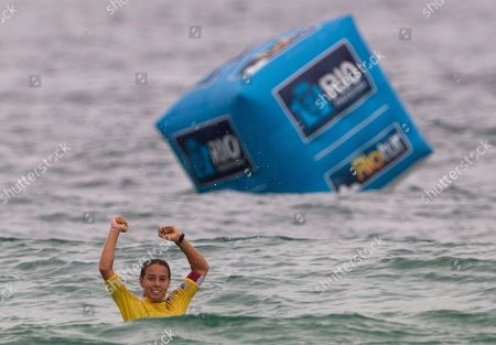 Australia's Sally Fitzgibbons celebrates after winning the Association of Surfing Professionals (ASP) Billabong Rio Pro women's surfing competition at Barra da Tijuca beach in Rio de Janeiro, Brazil