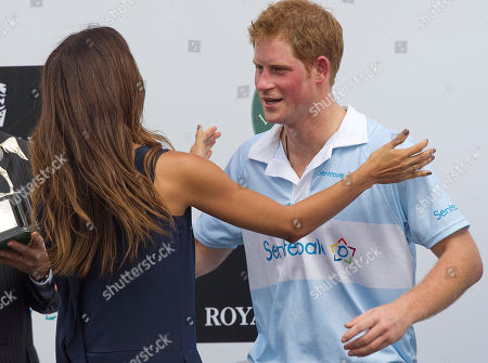 Prince Harry Britain's Prince Harry greets Brazil's model Fernanda Motta during an award ceremony after playing a charity polo match in Campinas, Brazil, . Prince Harry is in Brazil at the request of the British government on a trip to promote ties and emphasize the transition from the upcoming 2012 London Games to the 2016 Olympics in Rio de Janeiro