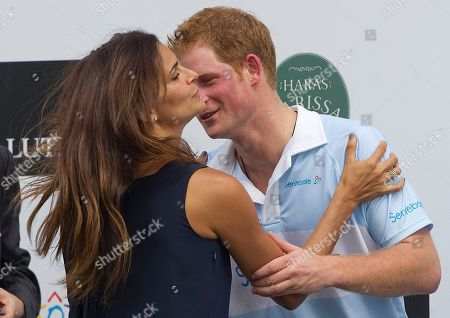 Stock Image of Prince Harry Britain's Prince Harry greets Brazil's model Fernanda Motta during an award ceremony after playing a charity polo match in Campinas, Brazil, . Prince Harry is in Brazil at the request of the British government on a trip to promote ties and emphasize the transition from the upcoming 2012 London Games to the 2016 Olympics in Rio de Janeiro