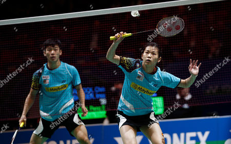 Liu Ying Goh, right, of Malaysia plays a shot as her partner Peng Soon Chan looks on on their way to quarter final victory over England's Chris Adcock and Scotland's Imogen Bankier at The All England Open Badminton Championships, Birmingham, England