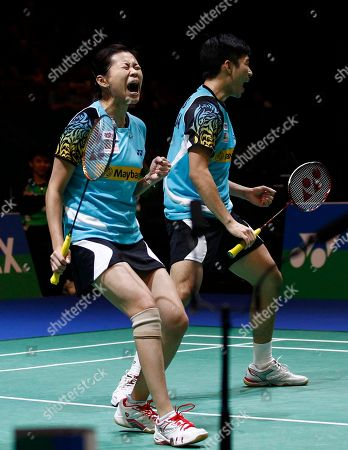 Liu Ying Goh, left, of Malaysia and her partner Peng Soon Chan celebrate winning a point on on their way to quarter final victory over England's Chris Adcock and Scotland's Imogen Bankier at The All England Open Badminton Championships, Birmingham, England