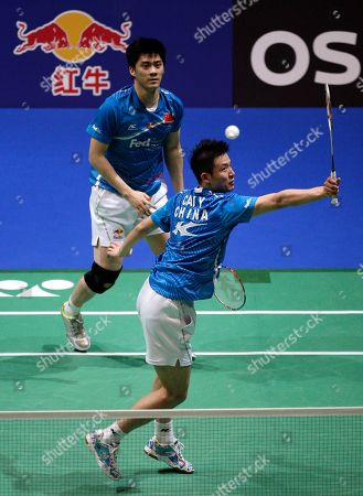 China's Yun Cai, right, plays a shot as his partner Haifeng Fu looks on during their defeat by South Korea's Yong Dae Lee and Jae Sung Jung in their men's doubles final at The All England Open Badminton Championships, Birmingham, England