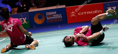 South Korea's Jae Sung Jung, right, and Yong Dae Lee rcelebrate their men's doubles final victory against China's Yun Cai and Haifeng Fu at The All England Open Badminton Championships, Birmingham, England