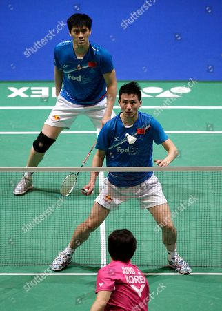 China's Yun Cai, centre, and Haifeng Fu watch a shot during their defeat by South Korea's Yong Dae Lee and Jae Sung Jung in their men's doubles final at The All England Open Badminton Championships, Birmingham, England