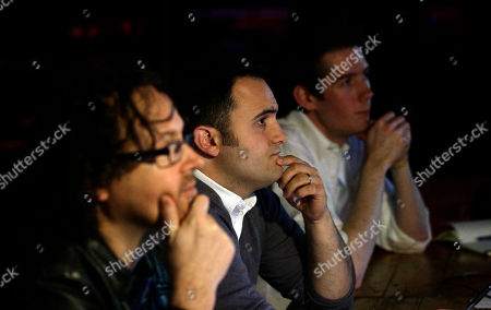 Casting director James Hopson, centre, John Maher, UK music supervisor, left, and Jamie Hendry, producer, watch musicians audition at the Cavern Club for a part in Let It Be, a theatrical concert celebrating the music of The Beatles, Liverpool, England, . Let It Be will run at the Prince Of Wales Theatre in London from September 2012