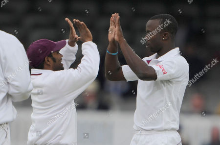 Kemar Roach, Adrian Barath England's Andrew Strauss falls to West Indies Kemar Roach, right, who celebrates with Adrian Barath during the 4th day of the first test match at Lord's cricket ground, London