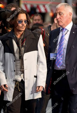 Johnny Depp, Jerry Judge Actor Johnny Depp, left, and his personal security guard Jerry Judge, arrive for the UK Premiere of 'Dark Shadows', at a central London cinema