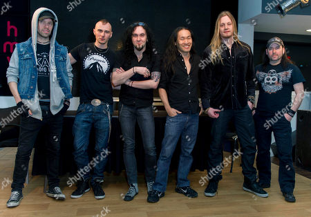 Stock Picture of Sam Totman, Vadim Pruzhanov, Frederic Leclercq, Herman Li, Marc Hudson, Dave Mackintosh, DragonForce From left, Sam Totman, Vadim Pruzhanov, Frederic Leclercq, Herman Li, Marc Hudson and Dave Mackintosh, from British Rock group, DragonForce, pose for photographers at a Central London venue