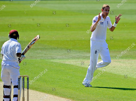 Stuart Broad, Adrian Barath England's Stuart Broad, right, celebrates after he claims the wicket of West Indies' Adrian Barath during the first day of the 2nd Test match at the Trent Bridge cricket ground, Nottingham, England